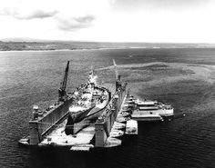 with West Virginia high and dry in the dock, off Aessi Island, Espiritu Santo, New Hebrides, 13 November The battleship was docked for upkeep and repair to propellers damaged when she touched ground off Leyte on 21 October. Naval History, Military History, Military Art, Navy Coast Guard, Us Battleships, Go Navy, Leyte, Iwo Jima, History Online