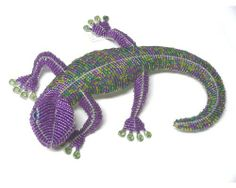 "Beaded Gecko - Tropical Decor - Purple and Green - Hand Crafted Art - 12"" Long X 9.25"" Wide - New by Florida Gifts. $38.99. Created with galvanized wire and glass beads. Approximately 12"" Long X 9.25""   Wide. Indoor/outdoor. Hand Crafted Tabletop Art. Beaded Gecko - Purple and Green. Beaded Gecko.  Tropical Decor - Purple and Green.  Hand Crafted Art.  12"" Long X 9.25""  Wide.  New.    Created with galvanized wire and glass beads. Indoor/outdoor. The process of hand cra..."