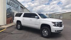 "2017 Chevrolet Suburban  with 4"" BDS lift and 285/50r22 tires"