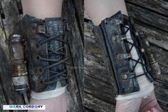 Post Apocalyptic armour vambrace made from an old army boot top with clip-on torch. Mark Cordory Creations. www.markcordory.com