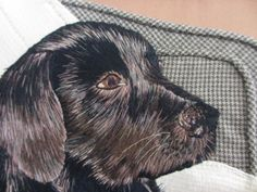 Lovely, realistic picture of dog rendered in silk embroidery. Just want to reach out and pet it.