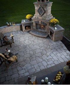 Outdoor fireplace out the dining/great room door