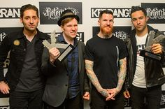 Fall Out Boy at the Kerrang Awards. all four of them are beautiful, but Joe just looks like a model in this picture. i miss his hair though