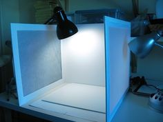 Home-made light box for photographing jewelry and other small objects. I'm going to try this.