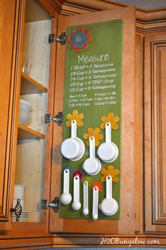 Measuring cup and spoon that hangs in the kitchen cabinet looks adorbale and keeps everything organized and easy to reach www.H2OBungalow.com