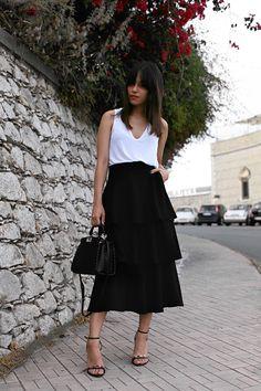 Nisi is wearing: Zara Ruffled skirt and white top, Fendi Mini Peekaboo, Proenza Schouler Heels, Silver Mesh Watch, Nars Red Square Lipstick