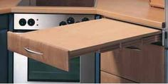 Pull out cutting board. Efficient space solution for prep and landing area.