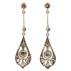 Victorian Diamond Silver Gold Dangle Earrings. Victorian handmade 1860 to 1870 dangle earrings with yellow gold backs and Sterling silver tops set with all original rose cut diamonds.