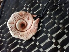 Texture Spiral Handcrafted Polymer Clay Pendant with Acrylic Wash. $16.00, via Etsy.