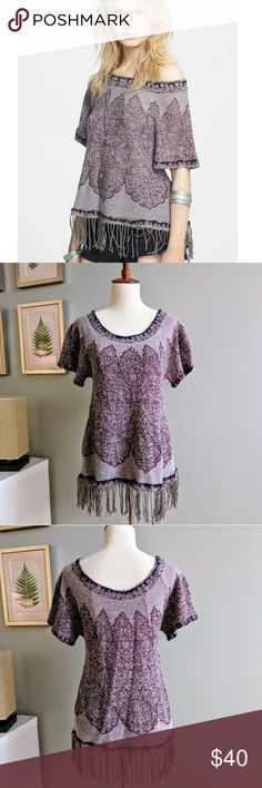 Free People Kilm Swing Top An exotic knit design lends world-market appeal to a slouchy elbow-sleeve top tailored with a wide, shoulder-baring neckline and finished with loads of swingy tassels at the hem. Rayon/wool blend. Size Medium. Free People Sweaters