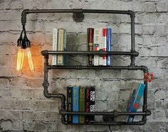 Book-friendly industrial pipes. More Info: 9th Ave Iron Works Lighted Brighton Two Tiered Iron Bookshelf - NoveltyStreet