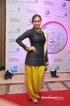 Maria Goretti. Short black kurti teamed with dhoti salwar and offwhite dupatta