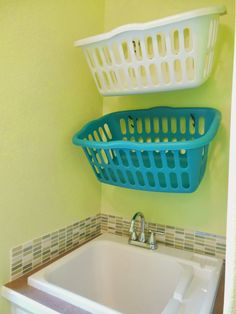 laundry basket wall | Up went the baskets, one for whites and one for darks.