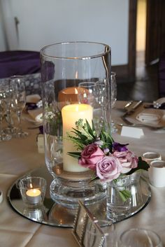 Flower Design Events: Simple Hurricane lamp design and posy of flowers, both were used to decorate the aisle during the ceremony