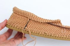 How to whip stitch and edge to sew a crochet project together.