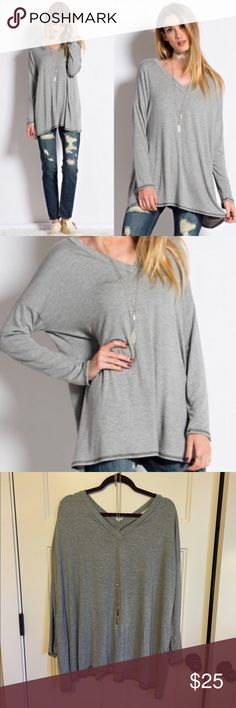 Grey Tunic Top Super super soft and cute tunic! Size medium but way too big for me. I'm usually a small. Has an oversized tunic fit, perfect for fall. Never been worn, just bought it. Tops Tunics