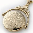 """""""Elizabeth"""" Revolving Locket in 14K Yellow Gold with floral hand engraving."""