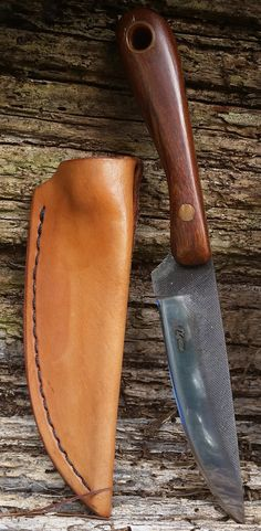 Cut from a Nicholson File, sanded, heat treated and fit with a wood handle and leather belt sheath. Overtock knives stamped MLyons prior to naming my company. Total length in sheath is 8.25. Total lenght of knife only is 7.5.