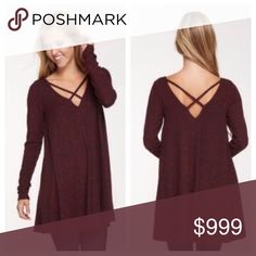 """NWT Burgundy Strappy Front & Back Tunic/Dress Brand new in original packaging.  Marled burgundy super soft brushed knit long sleeve v-neck tunic or dress with cross detail front and back, round hem, stretchy, loose fitting.  Polyester/Rayon/Spandex.  Approx measurements laying flat: SMALL chest 19"""" length 31"""" MED chest 20"""" length 31.5"""" LARGE chest 21"""" length 32"""".  Approx measurements laying flat: SMALL chest 19"""" length 31"""" MED chest 20"""" length 31.5"""" LARGE chest 21"""" length 32"""".  I am a size 6…"""