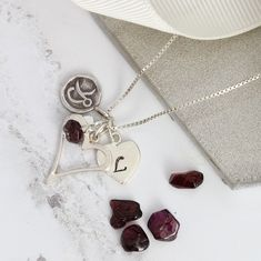 sterling silver open heart necklace personalised with letter charm and birthstone gemstone. The perfect gift for her Red Jewelry, Jewellery, Sterling Silver Heart Necklace, Zodiac Jewelry, Birthstone Necklace, Initial Charm, Birthstones, January, Garnet