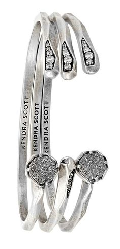 A dazzling set of platinum and silver cuffs are the perfect way to add a dash of…