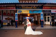 Us at our wedding venue on eastboune pier !