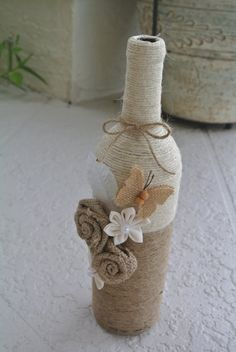 bottle crafts with twine Rustic decorated wine bottle, twine wrapped wine bottle, burlap wine bottle, country decorated wine bottle Twine Wine Bottles, Yarn Bottles, Liquor Bottle Crafts, Wrapped Wine Bottles, Wine Bottle Art, Painted Wine Bottles, Diy Bottle, Decorated Bottles, Vintage Bottles