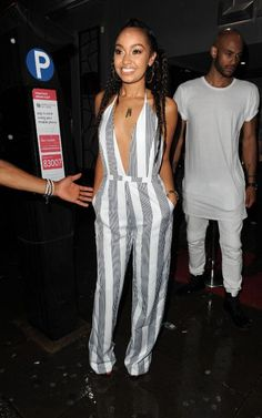 Leigh Anne Pinnock in a black and white stripe jumpsuit.