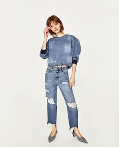 Denim is all the rage, and this cute crop denim top will look fab with high waisted trousers or skirts, or go the whole double denim vibe. Zara