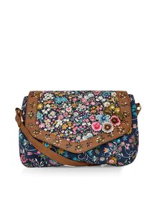 This pretty across-body bag is printed with wild flowers, and decorated with embroidered 3D blooms and a metal bow charm. Finished with cutwork leather-look trims, this canvas style also features an adjustable shoulder strap.