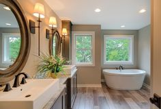 Would't you love to soak in this white freestanding bathtub after a long day? Home by DH Homes, photo by Spacecrafting.