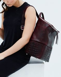 A women s luxury laptop backpack in burgundy leather with crocodile print  and silver zippers 08a296040df46