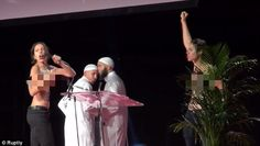 The unnamed women can be seen grabbing microphones, shouting out and punching the air as t...