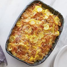 Squash Casserole | Why limit French fried onions to green bean casserole?  We love them on this cheesy squash casserole, too.