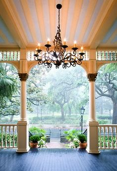This picture makes me happy.  I wish I could curl up in a chair on this front porch!