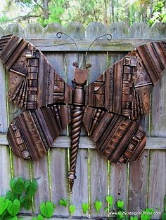 Giant wooden butterfly made with picture frame molding scraps, keys, metal hinges...4 feet across