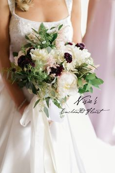 Nisie's Enchanted Florist -- Accenting white bridal bouquets with rich contrasting colors is chic and stylish. Don't be afraid to go bold! White peonies, burgundy scabiosas and dahlias, light pink astilbes, seeded eucalyptus. #nisiesenchanted #bridalbouquet #whitebouquet #weddingflorals