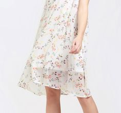 Simple and chic, this floral knee-length dress is perfect for exploring new cities. This pretty dress features shoulder drapes, side splits, back zip and inner lining. Wear with wedges for a relaxed holiday look.