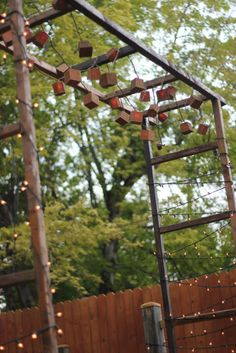 Make a Rustic Garden Pergola Tutorial: Use three vintage ladders to construct this sweet, mini pergola, a perfect place to hang lights or use as a backdrop for photos.