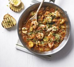 A fish casserole with healthy prawns, topped with an Italian garnish of parsley and lemon zest - it's low in fat and calories too