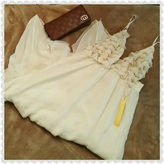 BNWT Angelic A+O dress Adorable cream A+O baby doll dress.The straps are adjustable and the band at the top is elastic.The bodice has some rufflinv and bead fringe detail.Flowy, flattering and super comfortable.The shell is made from 100% silk. Alice + Olivia Dresses