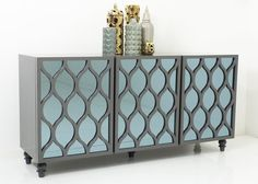 Don't be fooled by its diminutive size, the Petite Santorini Credenza packs quite a punch when it comes to style. Seen here in a charcoal greylacquer with inse