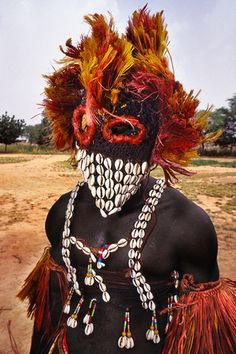 Mali mask with Cowrie Shells