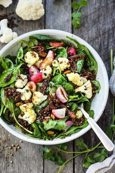 Afresh and flavorful Indian Spinach Salad with black lentils,roasted cauliflower and roasted radishes. Caramelized shallots and a Tempered Seed Dressing give the salad amazing flavor, depth and crunchy texture. #spinachsalad #indiansalad #vegan Indian Salads, Caramelized Shallots, Black Lentils, Lunch Snacks, Lunches, Farmers Market Recipes, Roasted Radishes, Fresh Fruits And Vegetables, Good Enough To Eat