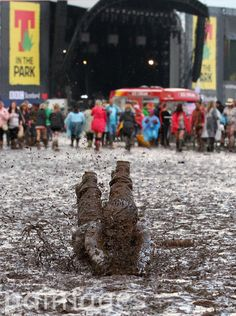 A festival goer, mud dives at the T in the Park music festival at Balado Park near Kinross.
