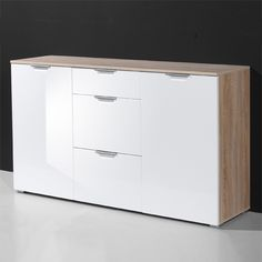 Decorate your corridors and hallways by placing this excellent furniture piece. Eva #sideboard comes in white gloss finish with top and side panels furnished in Canadian #oak color. It has stylish white #doors with 2 drawers in between.