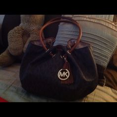 Michael Kors bag Brown leather bag   Retired and in mint condition   Used just a couple of times.   Price is firm. Michael Kors Bags