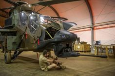 French Armée de Terre ground crew maintaining an ALAT (Army Light Aviation) Eurocopter Tigre light attack helicopter in Mali in 2014.