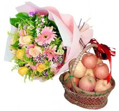 3 Kg Fresh Apples Basket along with Bouquet of Pleasant Flowers.