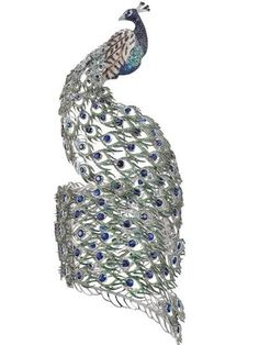 Absolutely fabulous Chopard peacock cuff, love the way the tail winds around the arm!